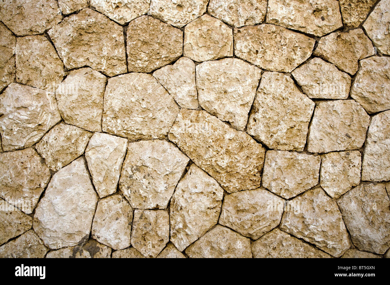 weathered stone wall background or texture - Stock Image