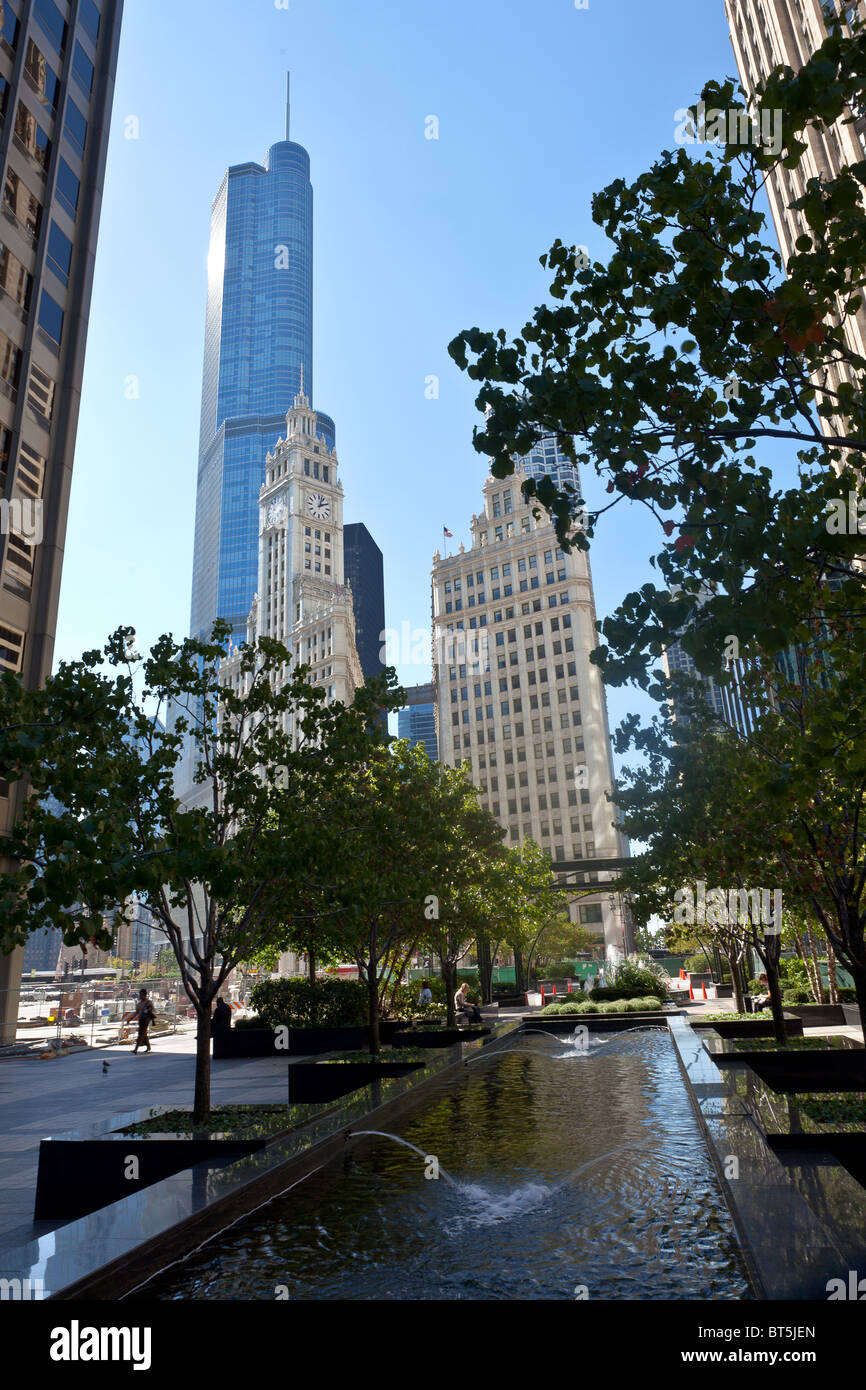 View of Trump Tower and the Wrigley Building from Pioneer Court in Chicago, IL, USA. - Stock Image