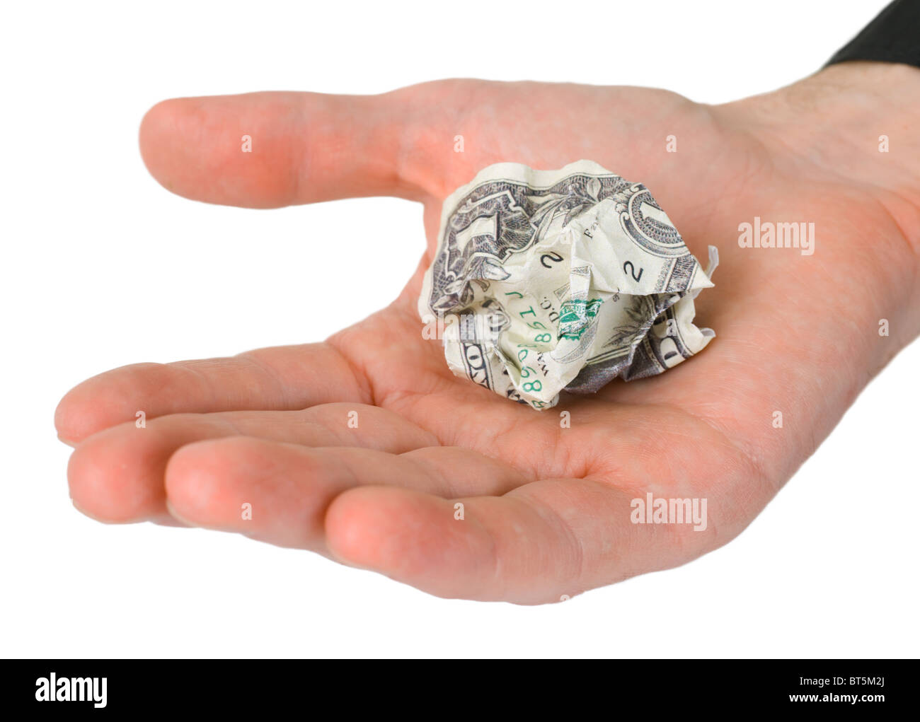Male hand holding crumpled dollar photographed on a white background - Stock Image