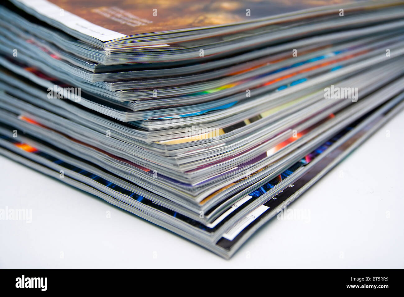 Close-up image of a stack of magazines - Stock Image