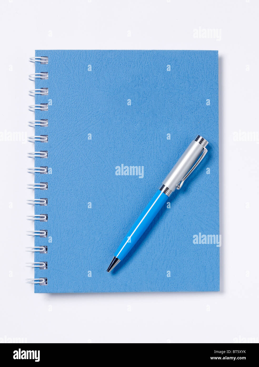 Spiral Blue Book diary ledger with pen elevated view - Stock Image