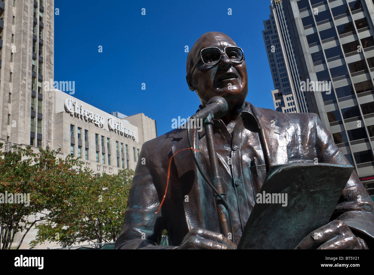 Statue of legendary Chicago broadcaster Jack Brickhouse in Pioneer Court along Michigan Ave Bridge in Chicago, IL, - Stock Image