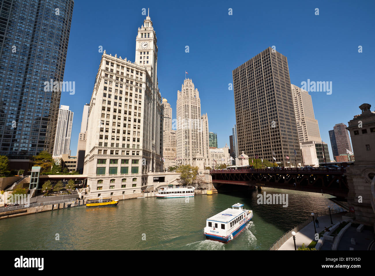 Chicago Tribune and Wrigley buildings along Michigan Ave with view of Chicago River Chicago, IL, USA. - Stock Image