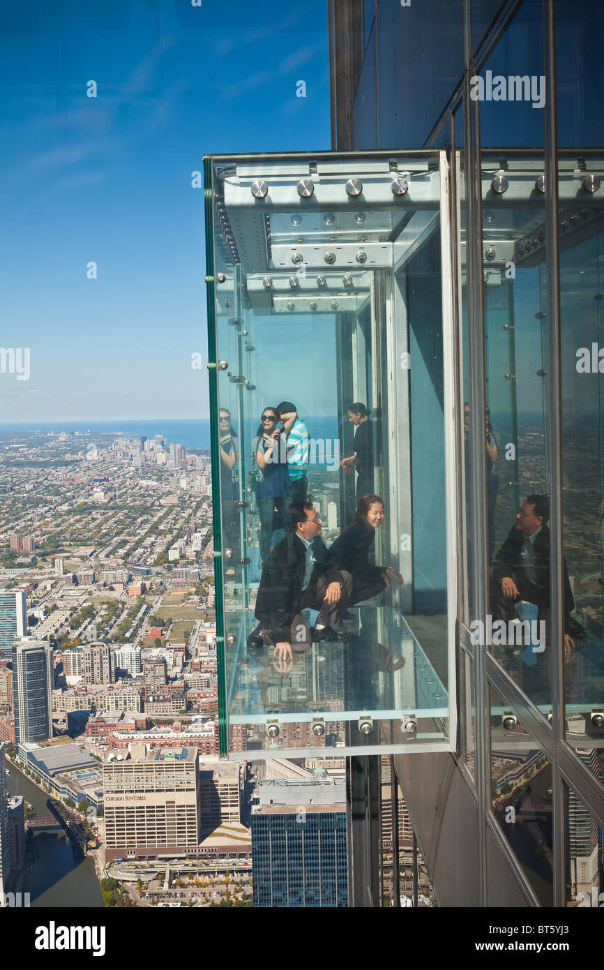 Tourists in glass balcony skydeck observation deck view ...