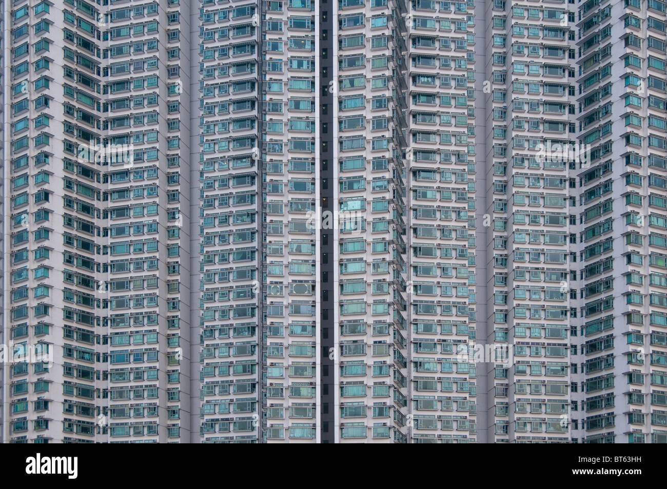 tower block high rise tung chung Kin  Road, Hong Kong sky scraper caribbean coast housing development overlooking - Stock Image