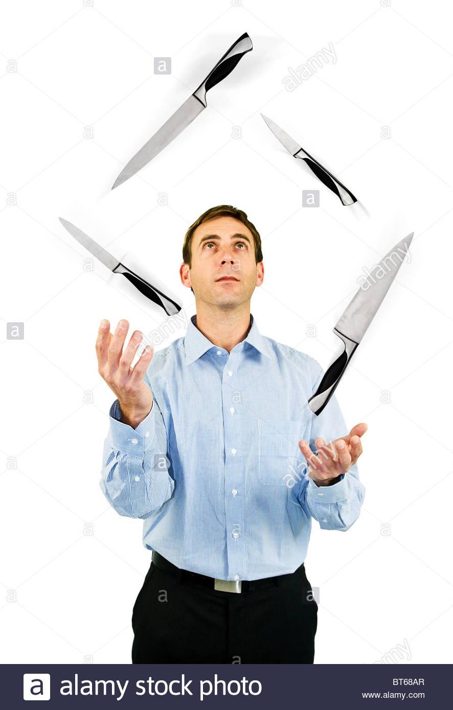 Juggling knives - Stock Image