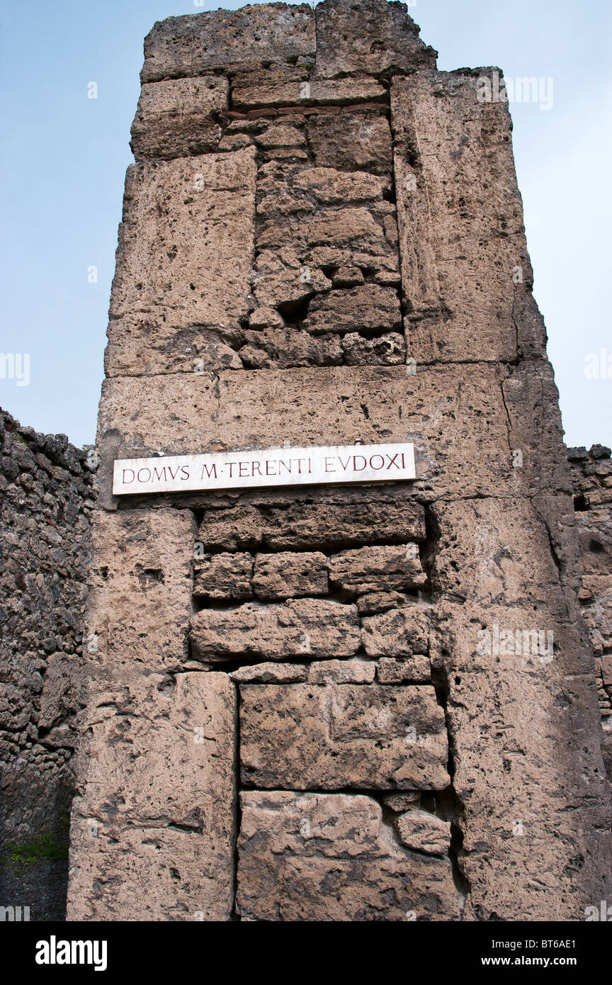 Vertical stone blocks contain horizontal stone layers in the cornerstone  pillar of a house 36f78e6b7