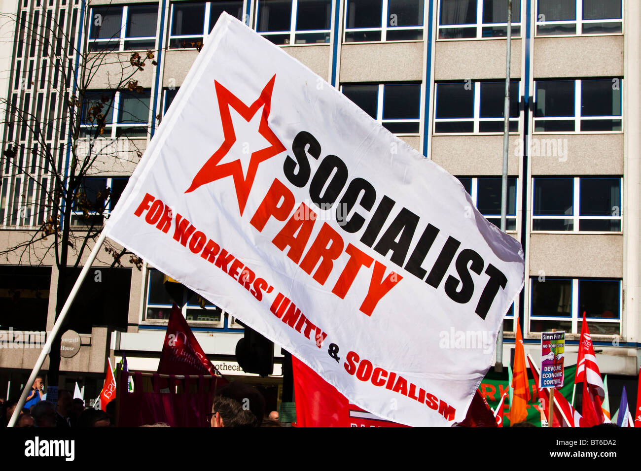 Socialist Party flag. Demonstration against government cuts, Belfast, 29 September 2010 - Stock Image