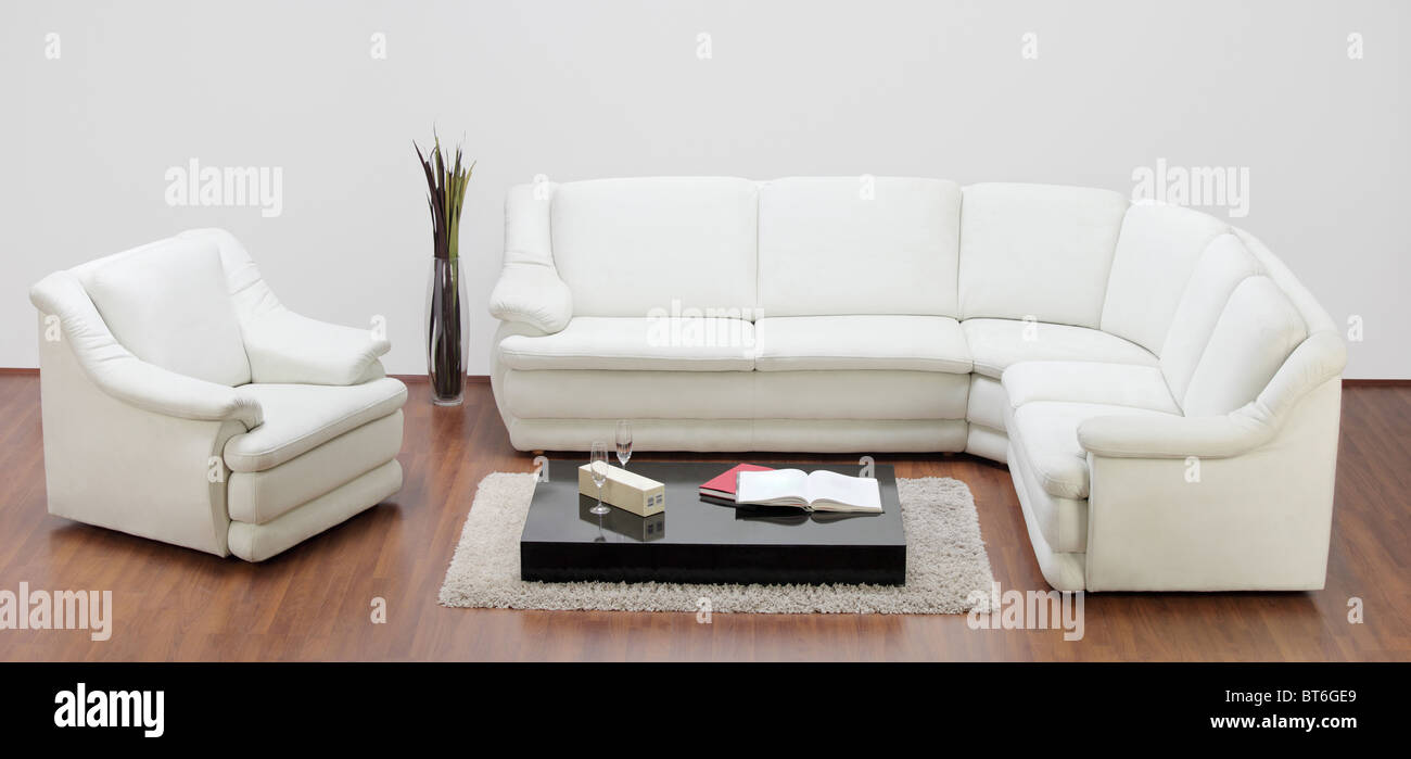 Studio shot of a white furniture, sofa and chair - Stock Image