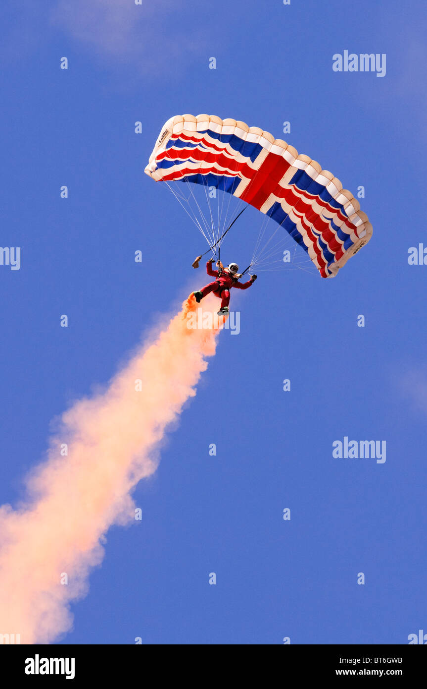 Red Devils parachutist performing at the Farnborough Airshow 2010 - Stock Image