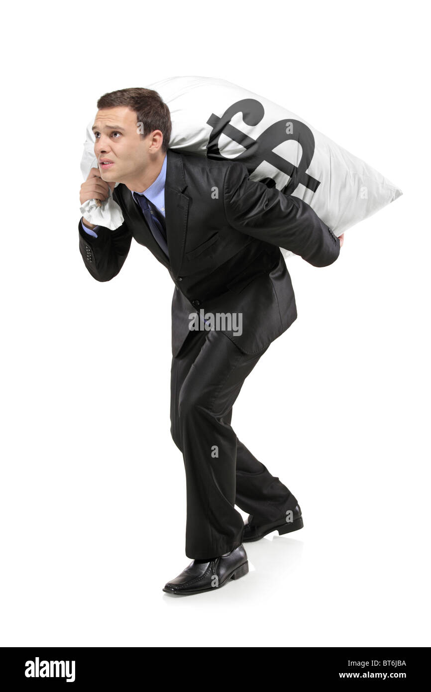 Full length portrait of a businessman carrying a money bag with US dollar sign - Stock Image