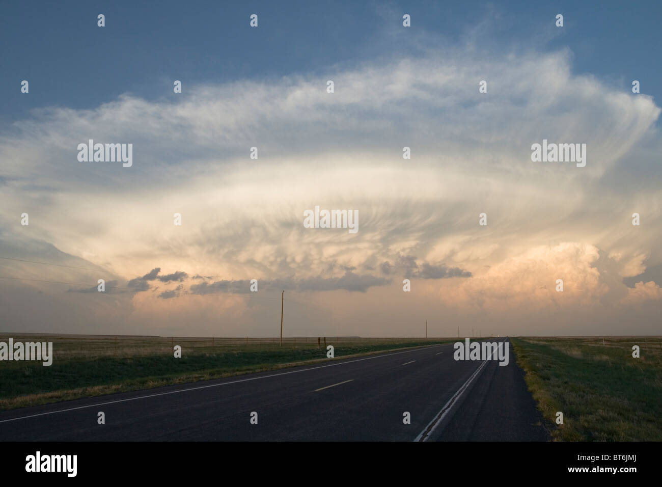 storm cloud above the horizon in the evening - Stock Image