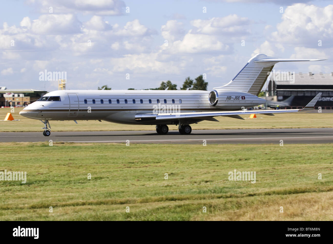 Bombardier BD-700 Global Express operated by TAG Aviation starting its take-off run at Farnborough Airport 2010 - Stock Image