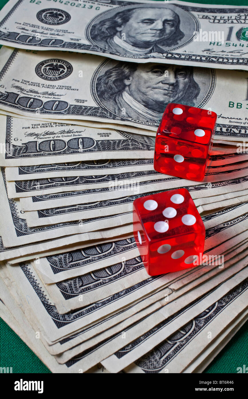 Hundred dollar bills and dice Stock Photo
