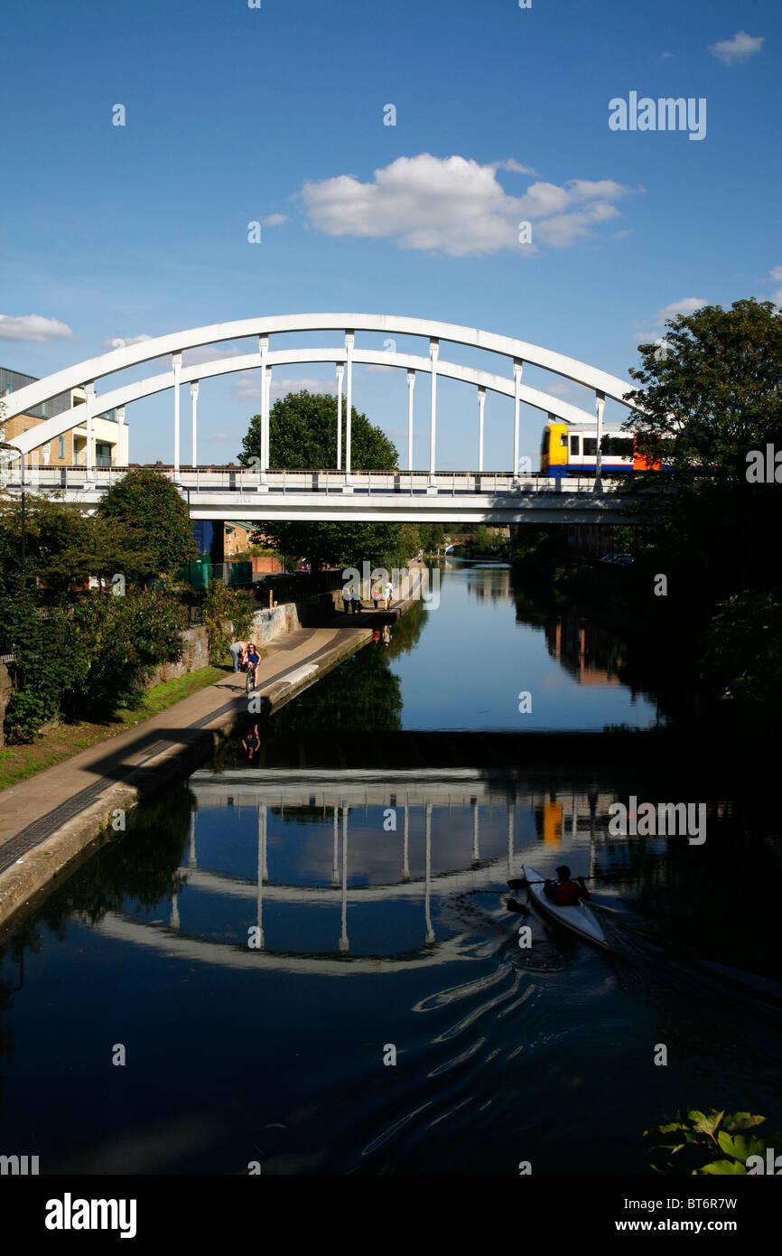 East London line (Overground) train crosses the Regent's Canal at Haggerston, London, UK - Stock Image