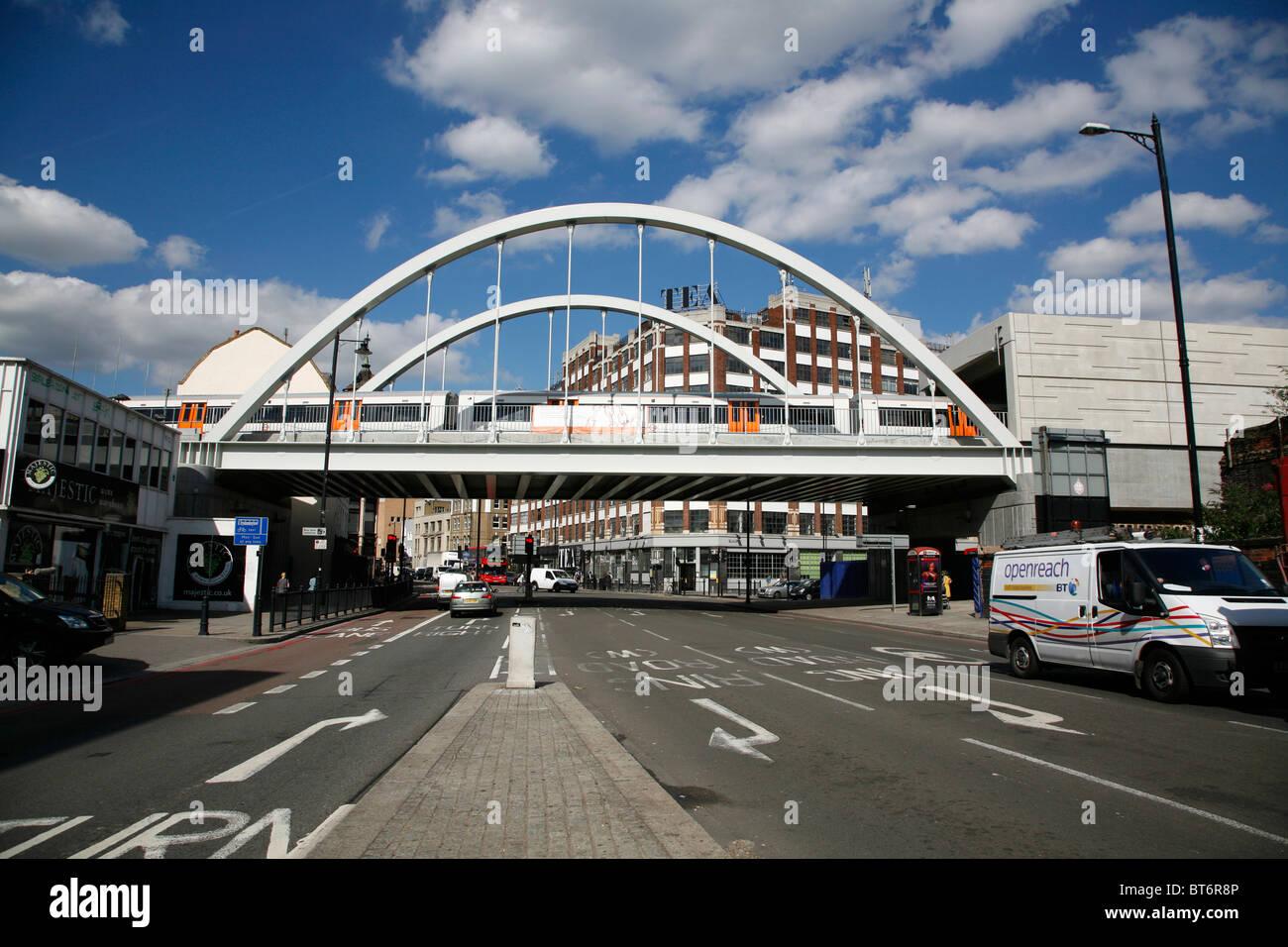 East London line (Overground) train crossing Shoreditch High Street, Shoreditch, London, UK - Stock Image