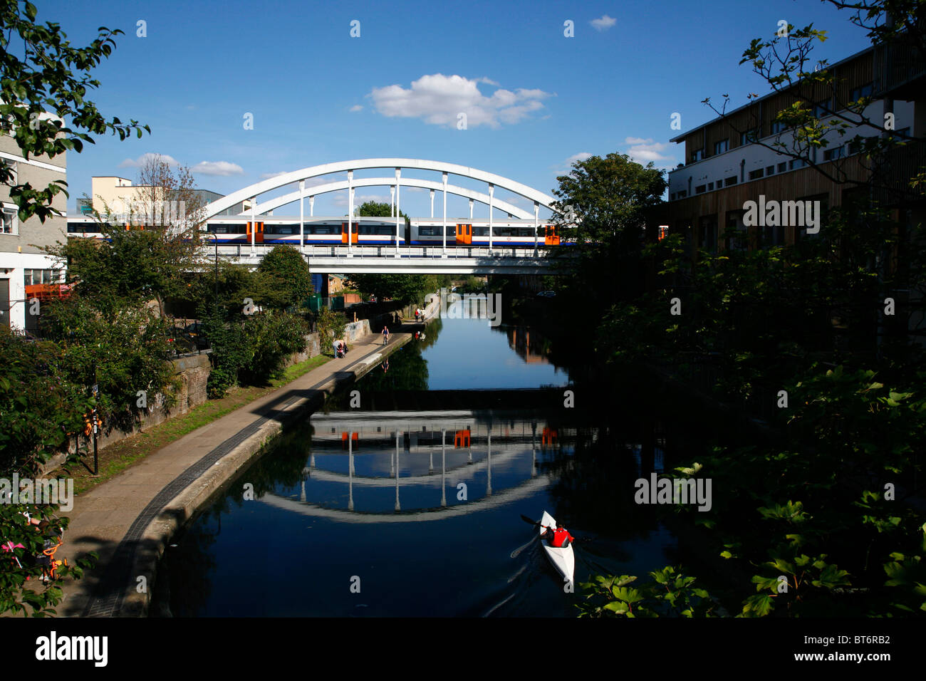 East London line (Overground) train crossing the Regent's Canal at Haggerston, London, UK - Stock Image