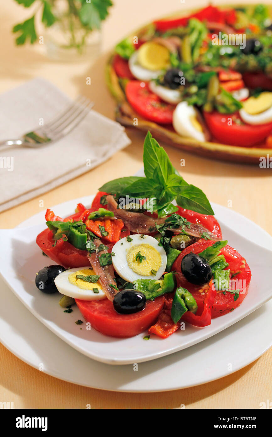 Anchovies and tomatoes salad. Step by step: PP42JH-PP42KF-PP42MA-PP42NP - Stock Image