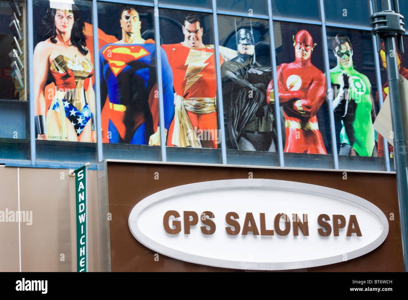 Superheros on a shop front - Stock Image
