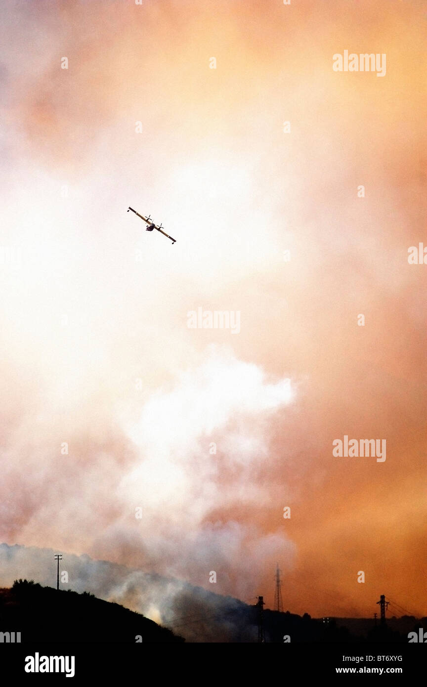 silhouette of a Canadair airplane in action - Stock Image