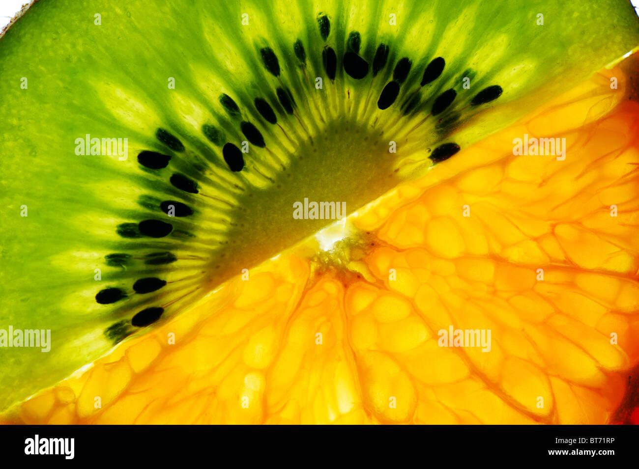 Sliced kiwi and mandarin Stock Photo