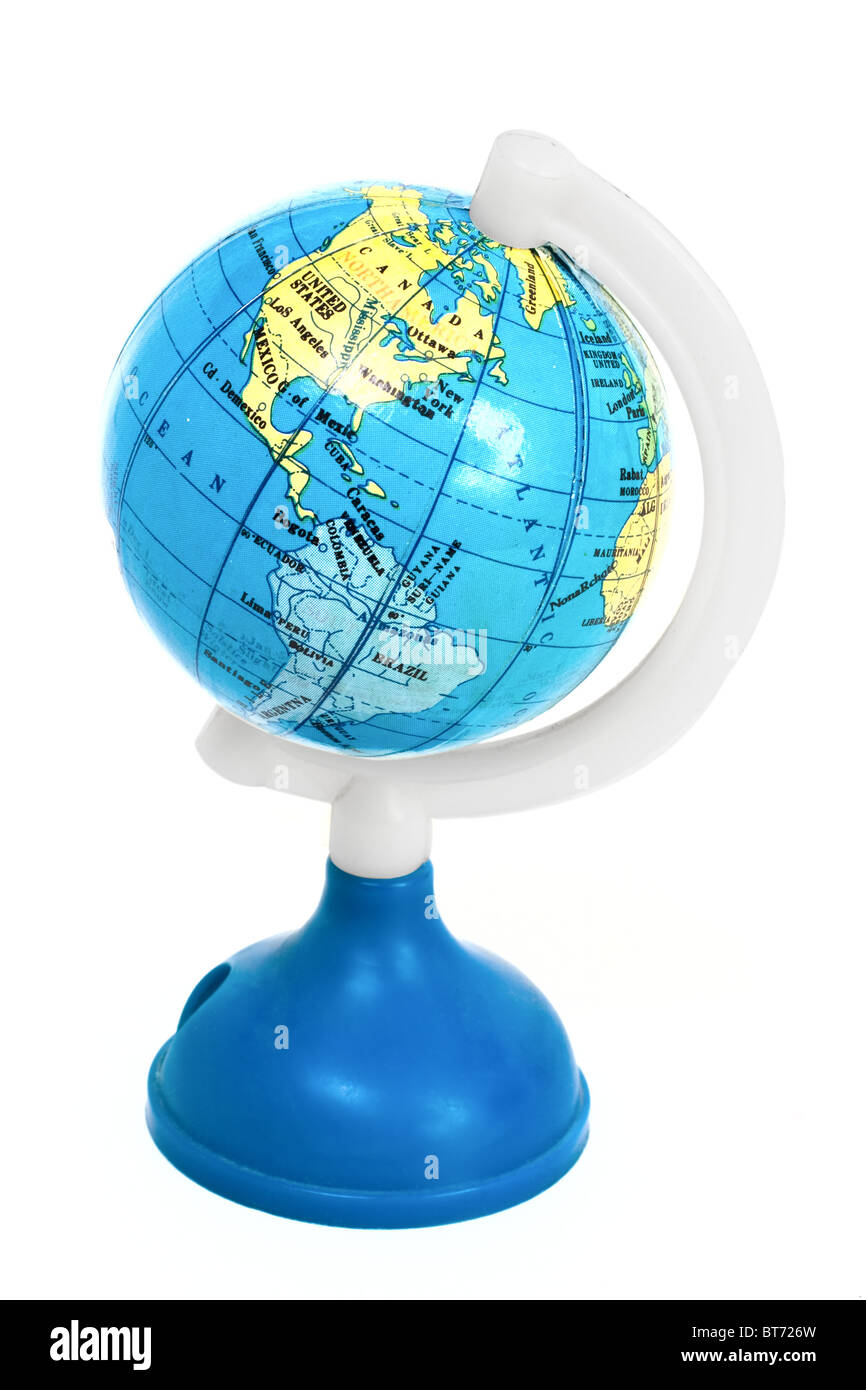 Small toy globe with South America and Atlantic Ocean isolated on white background - Stock Image