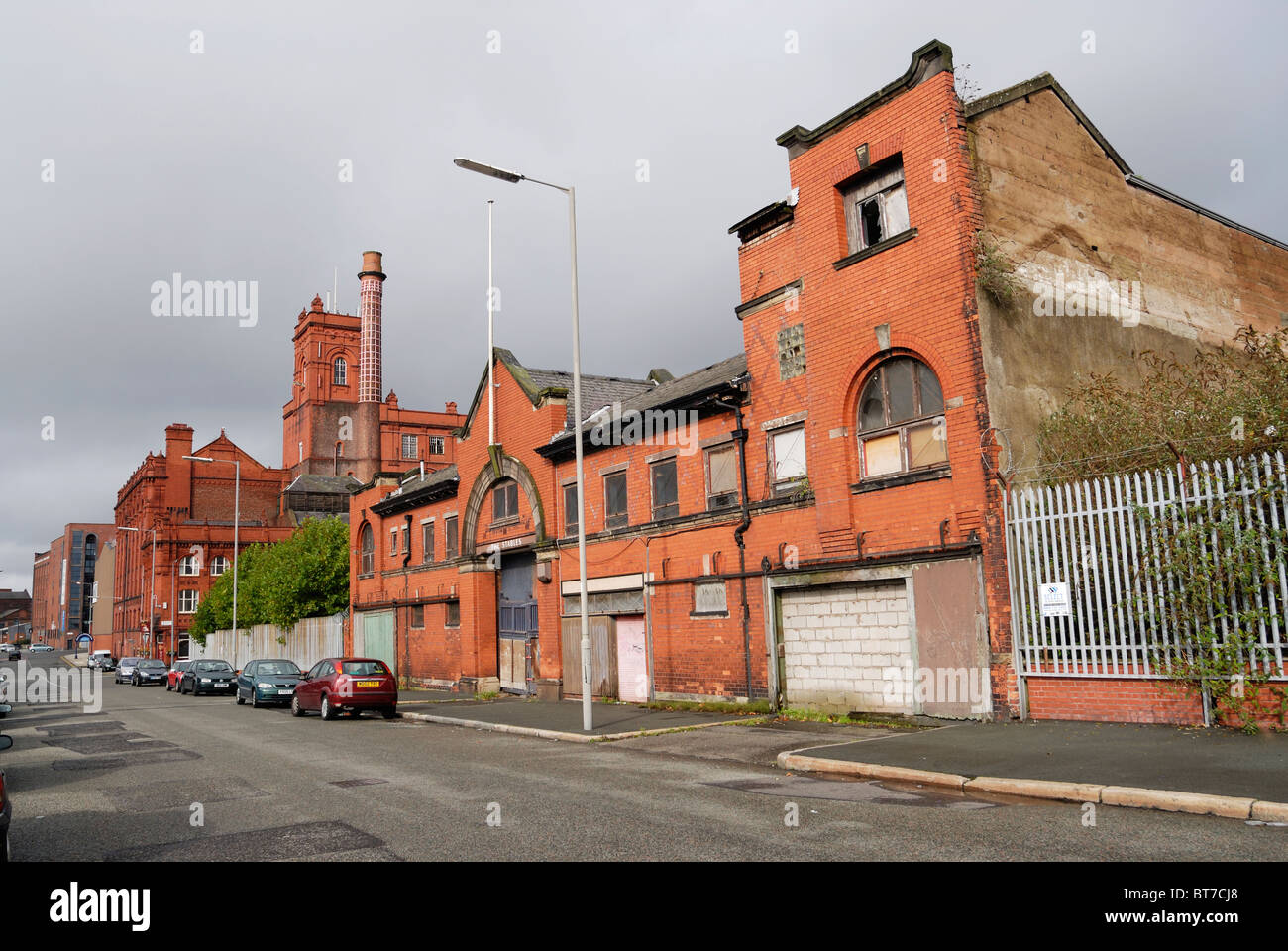 The stables for Cain brewery in Grafton Street, in a state of decay since Dray Horses are no longer used for beer - Stock Image