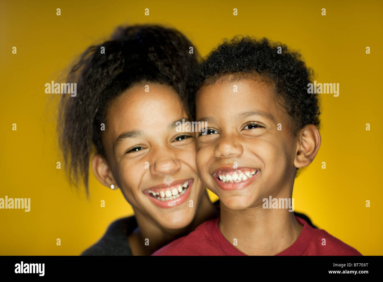 Portrait of Brother and Sister Smiling and having Fun - Stock Image