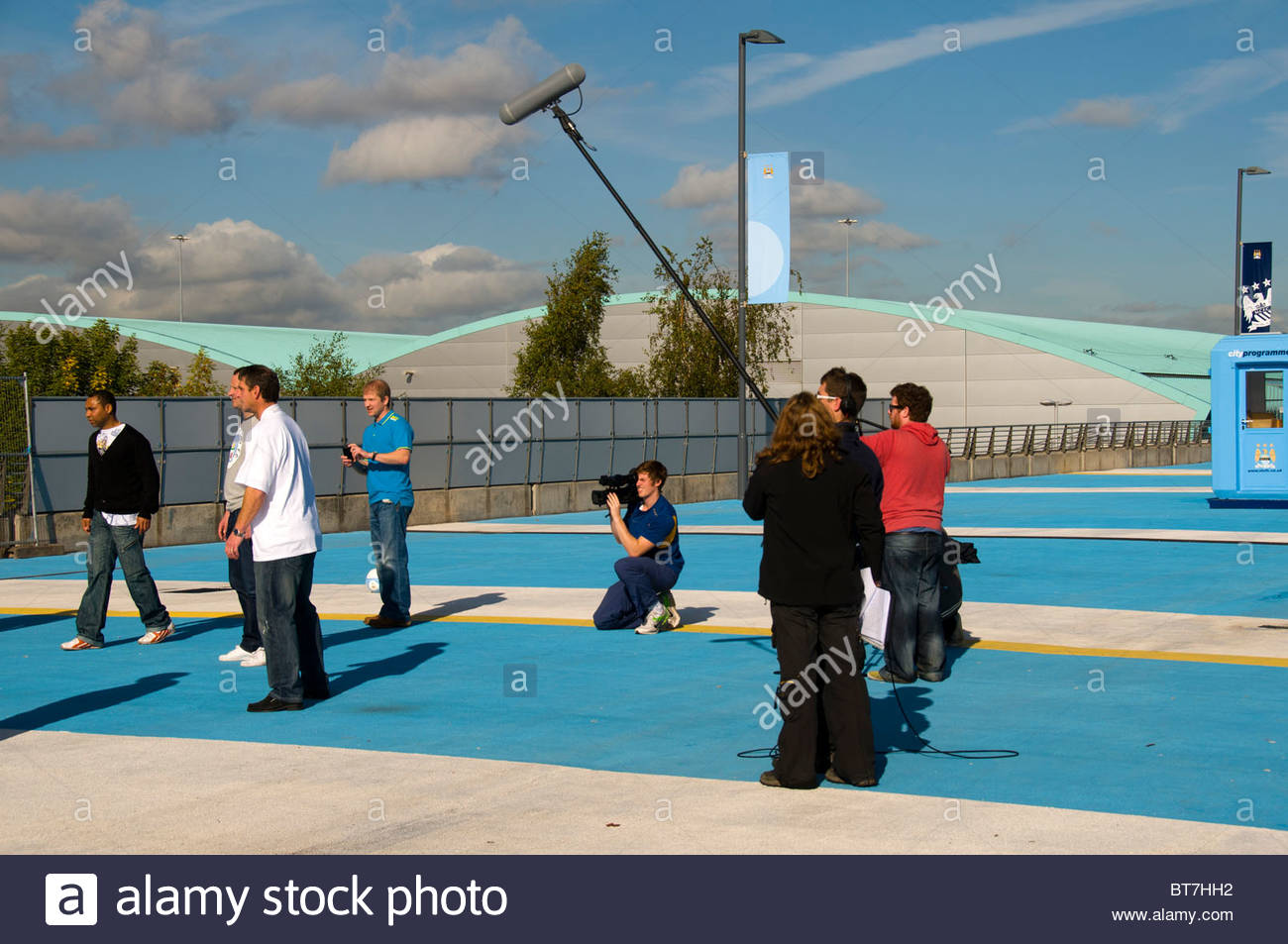 Group of former Manchester City football players being videoed at the City of Manchester Stadium, Manchester, England, - Stock Image