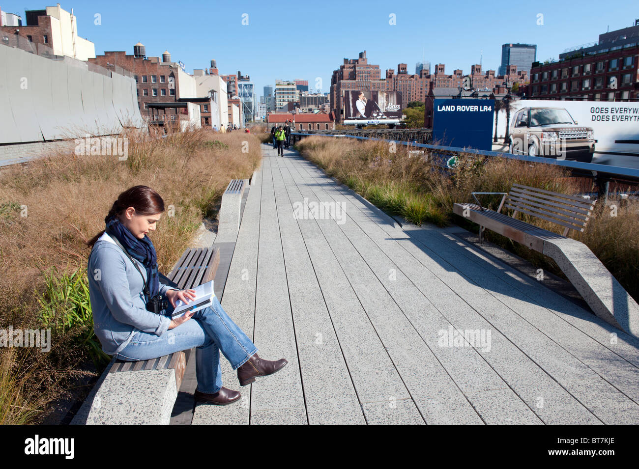 The High Line elevated landscaped public walkway built on old railway viaduct in Chelsea district of Manhattan in Stock Photo