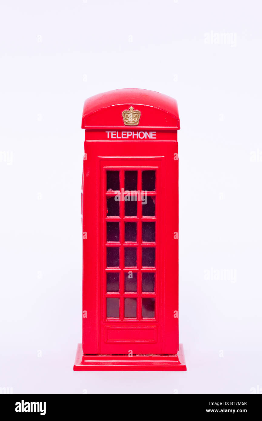 A close up photo of a model red old style telephone phone box against a white background - Stock Image