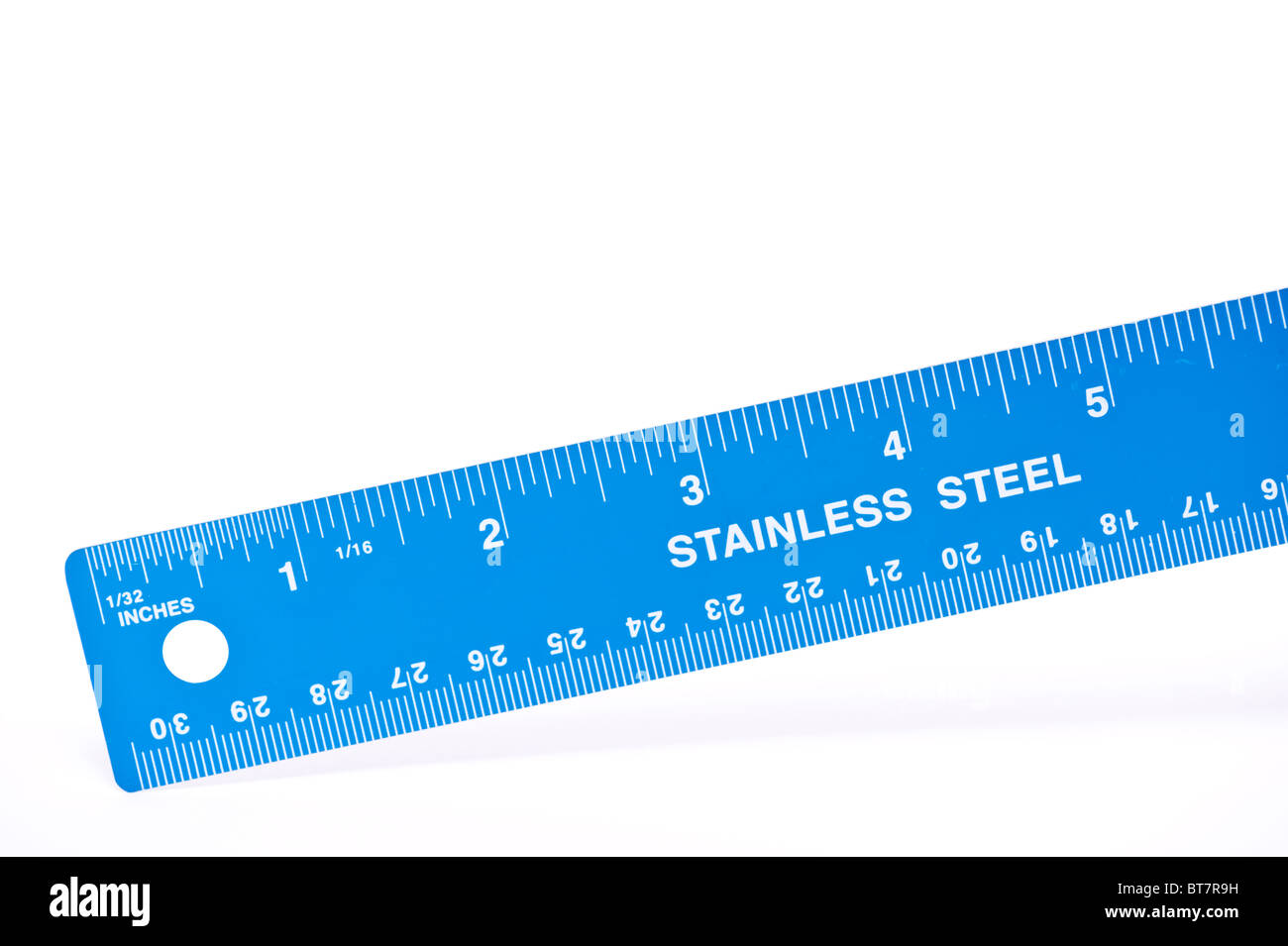 A close up photo of a blue stainless steel ruler against a white background - Stock Image