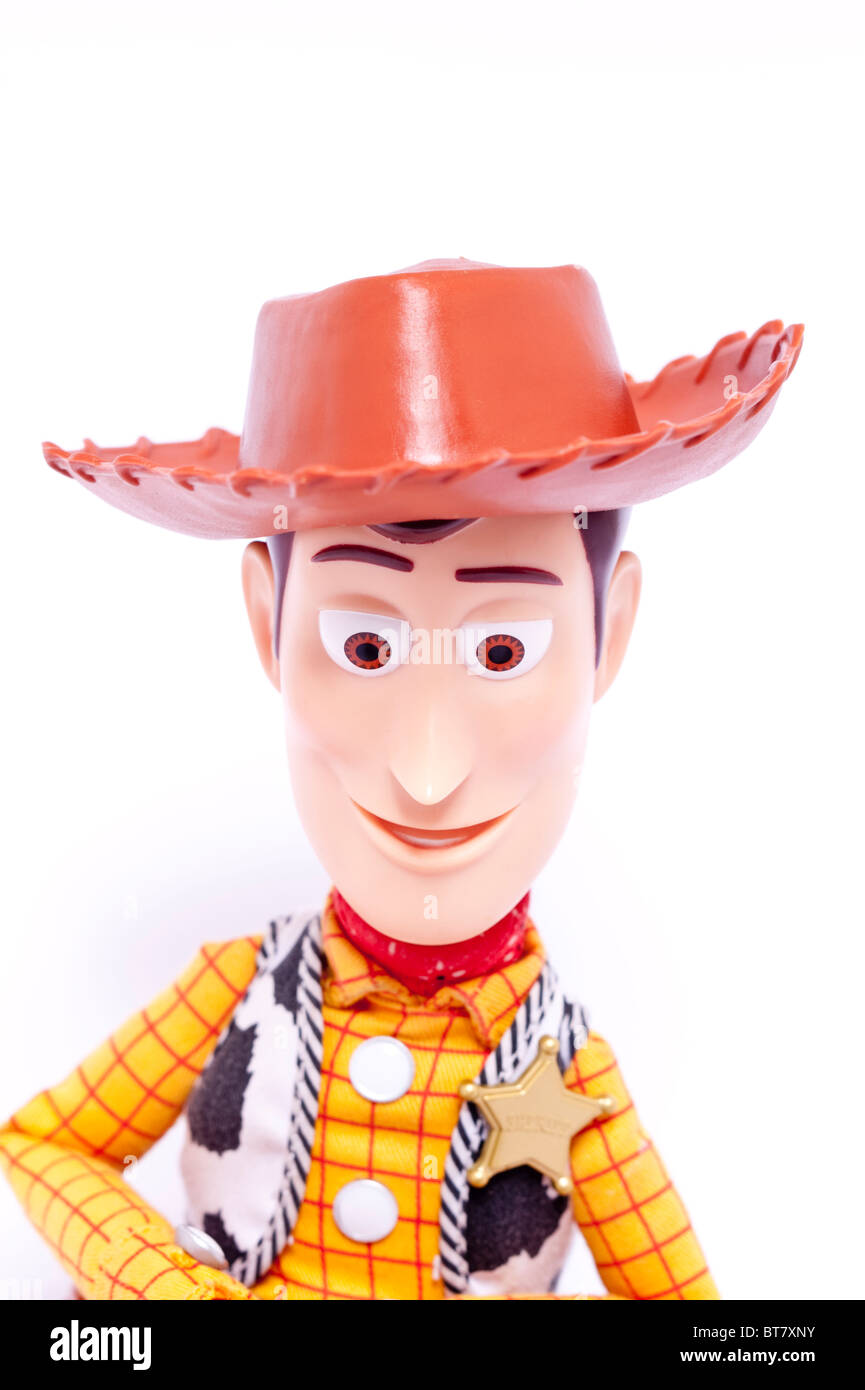 A close up photo of a childs toy Woody character from the Toy Story films against a white background - Stock Image