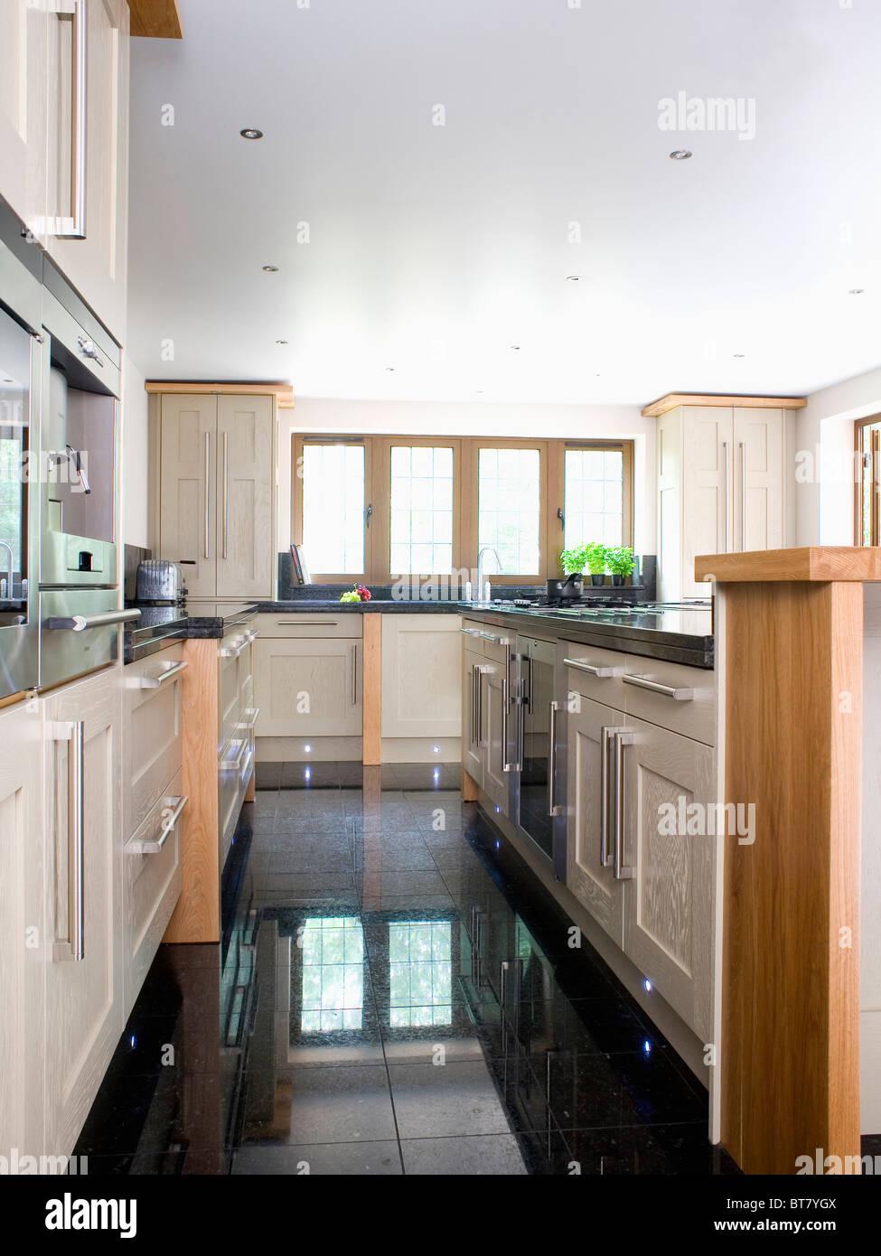 Black Granite Flooring In Large Modern Kitchen Extension Stock Photo Alamy