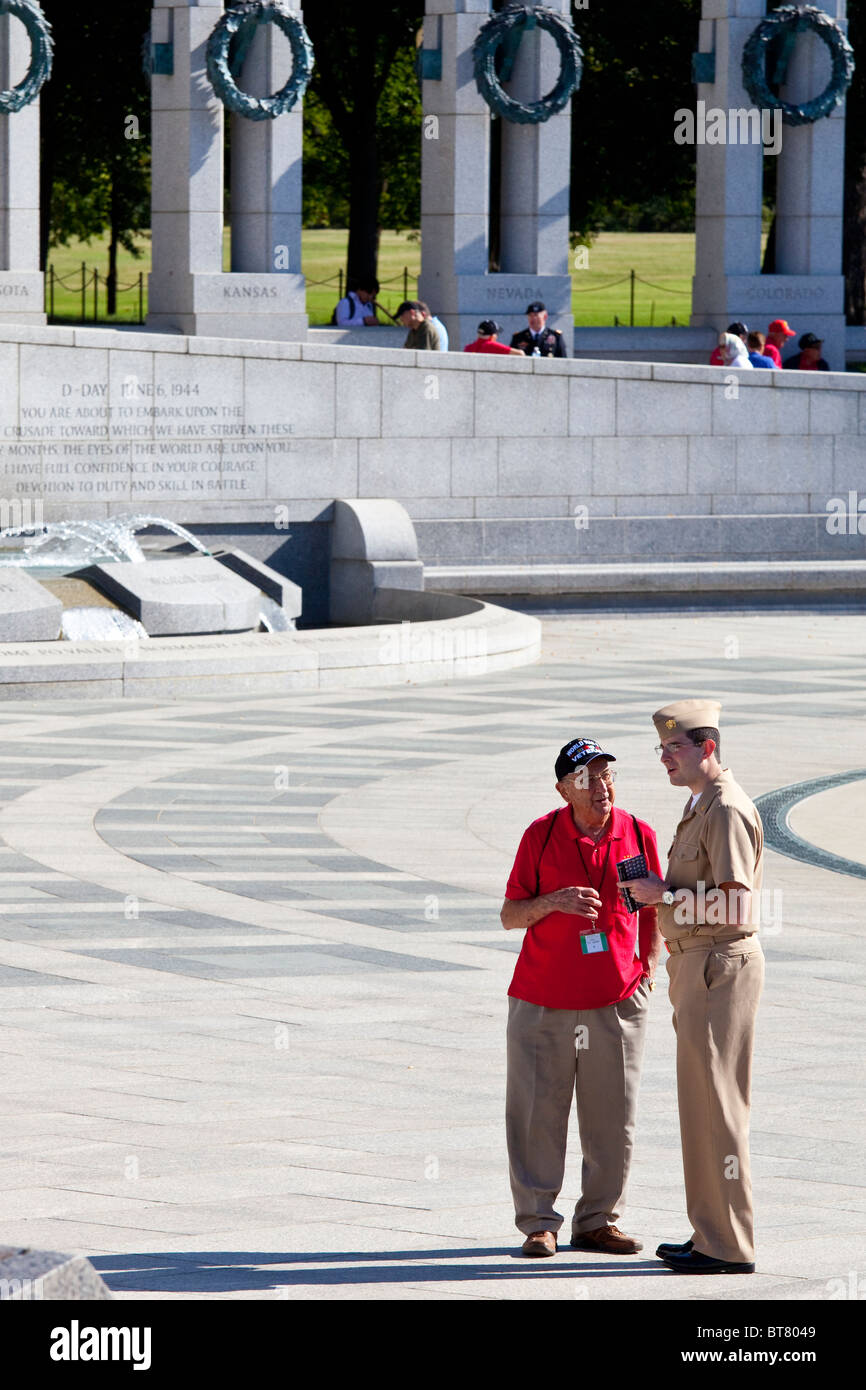 Veteran talking to active duty Military, National WWII Memorial on the National Mall in Washington DC - Stock Image