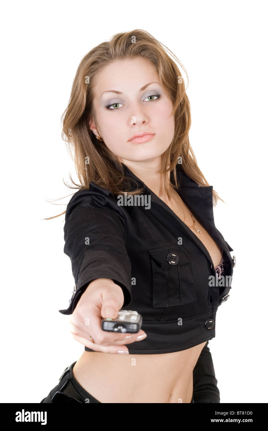 The beauty young woman with remote control - Stock Image