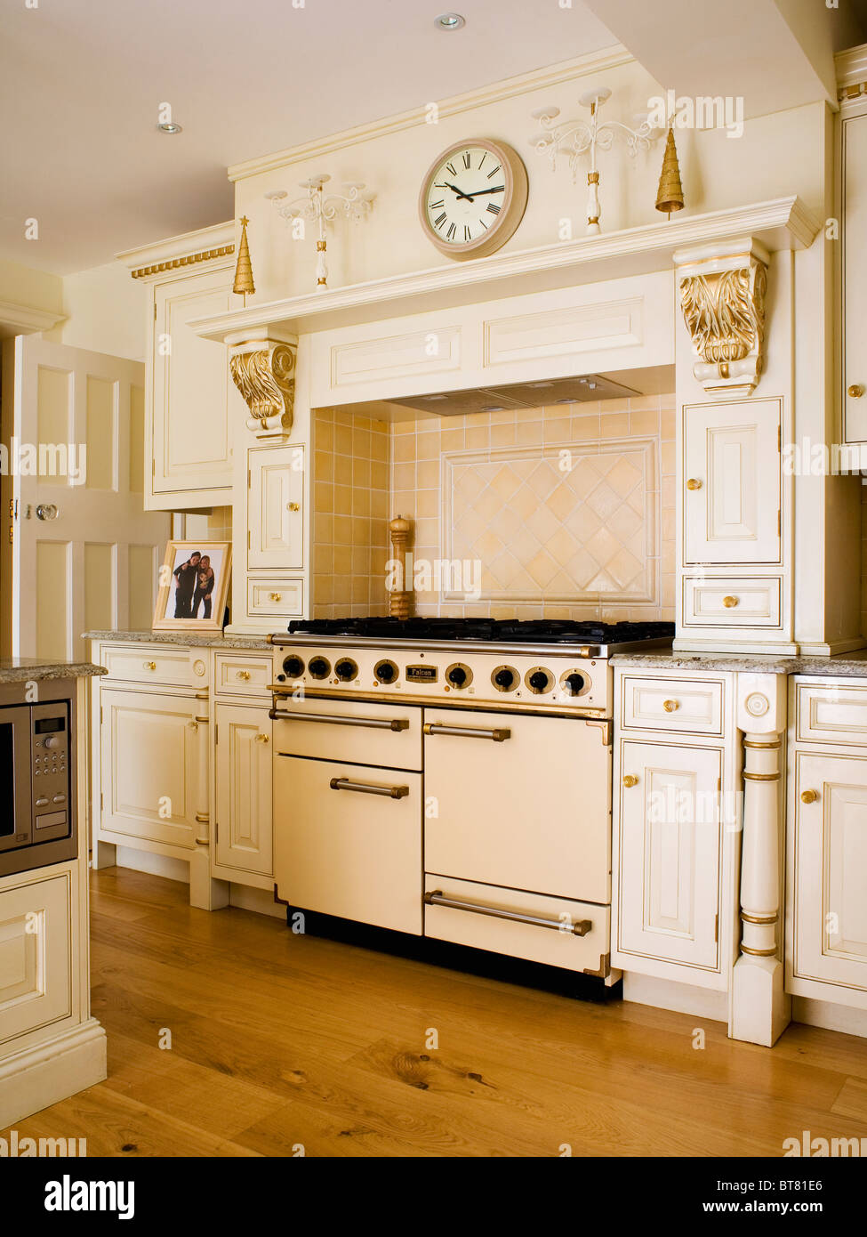 Cream range oven in traditional cream kitchen with gilt details on ...