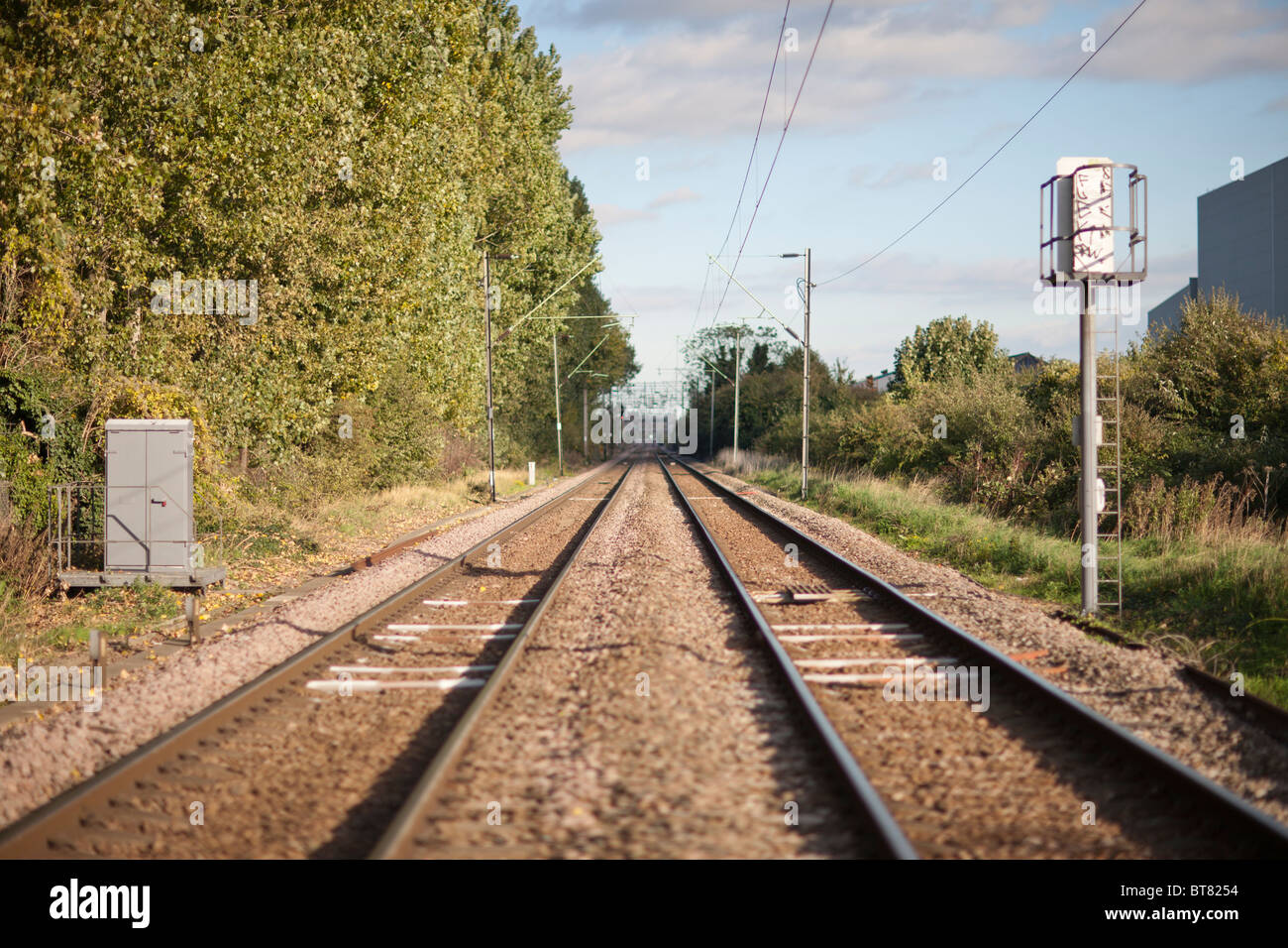 railway tracks,train lines in the distance,signals,sleepers,overhead lines - Stock Image
