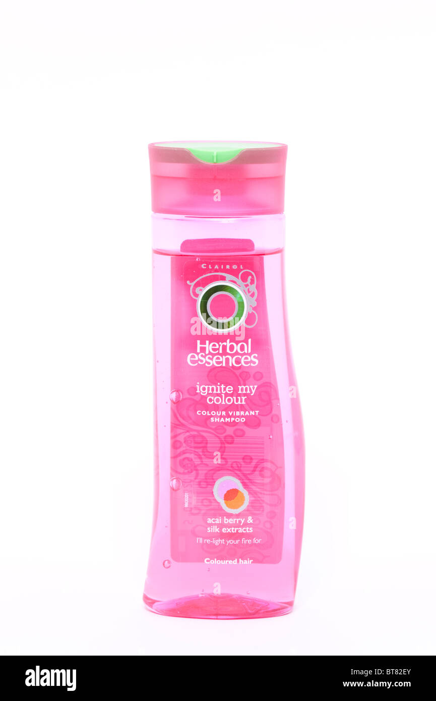 A close up photo of a bottle of Herbal essences hair shampoo against a white background - Stock Image