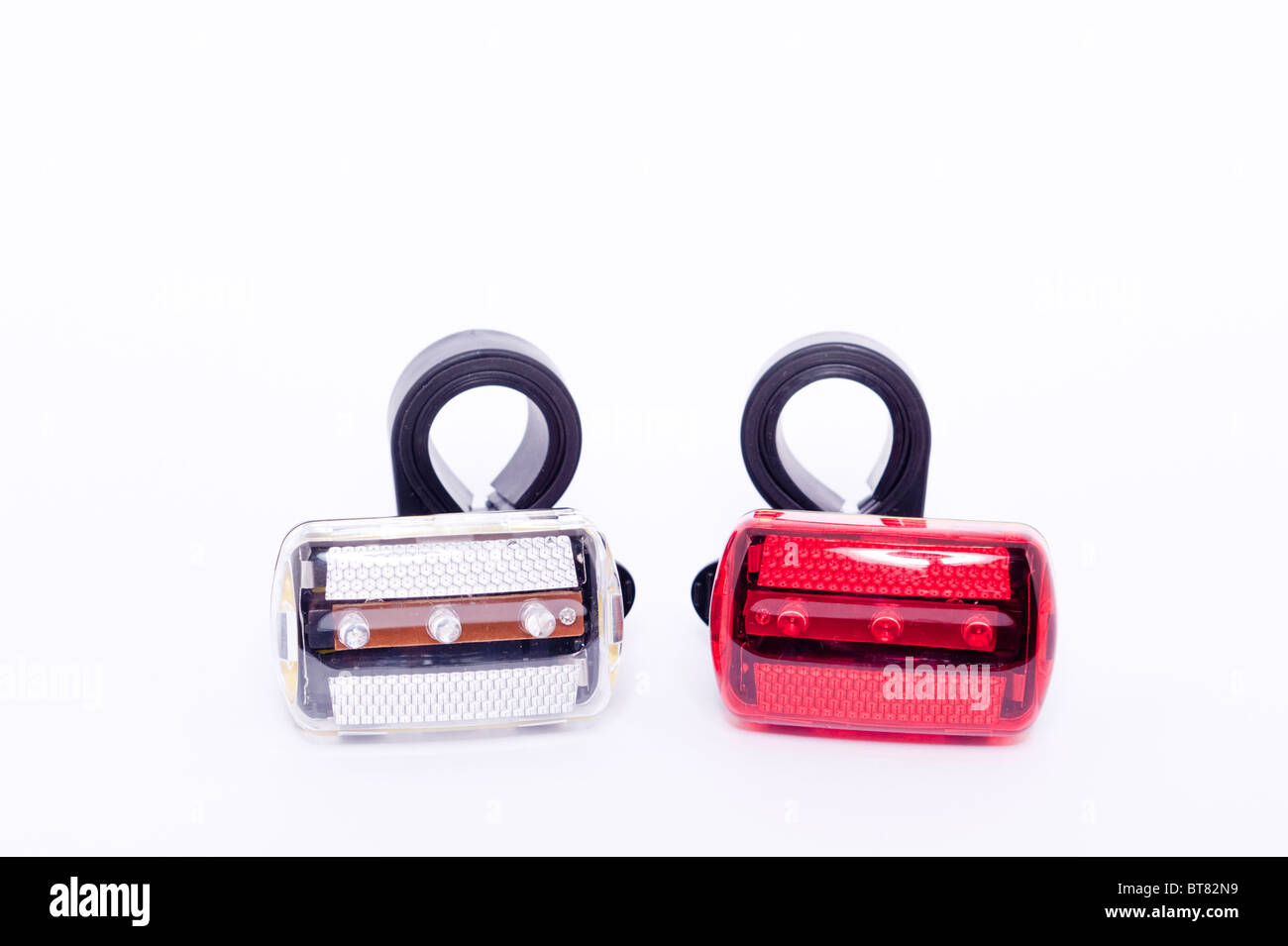 A close up photo of a pair of bicycle lights against a white background - Stock Image