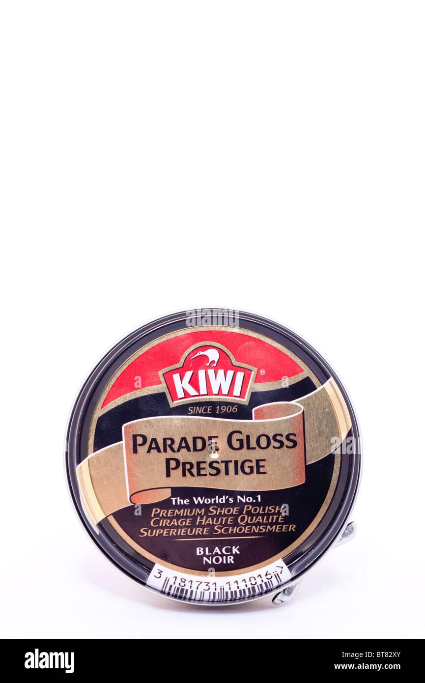 A close up photo of a tin of black Kiwi shoe polish against a white background - Stock Image