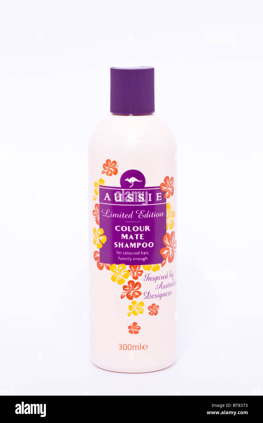A close up photo of a bottle of Aussie shampoo against a white background - Stock Image