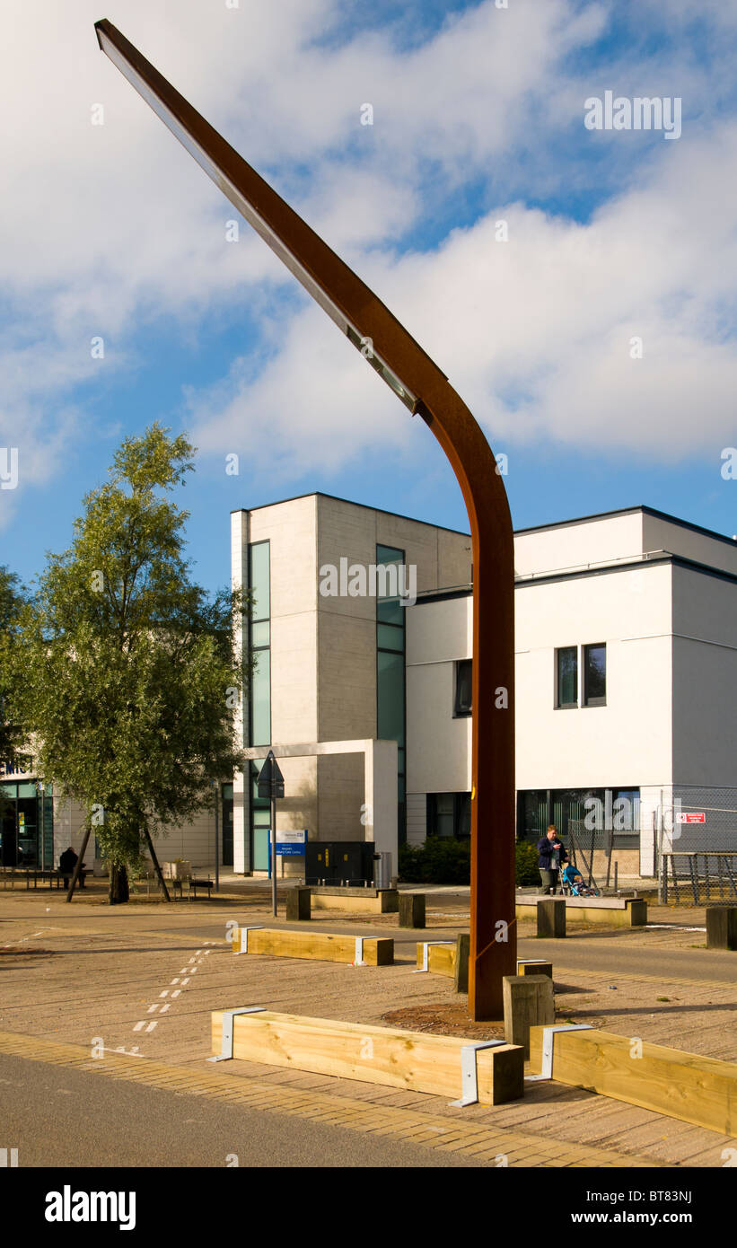 Ancoats Primary Care Centre and street lighting feature on Old Mill Street, New Islington, Manchester, England, - Stock Image