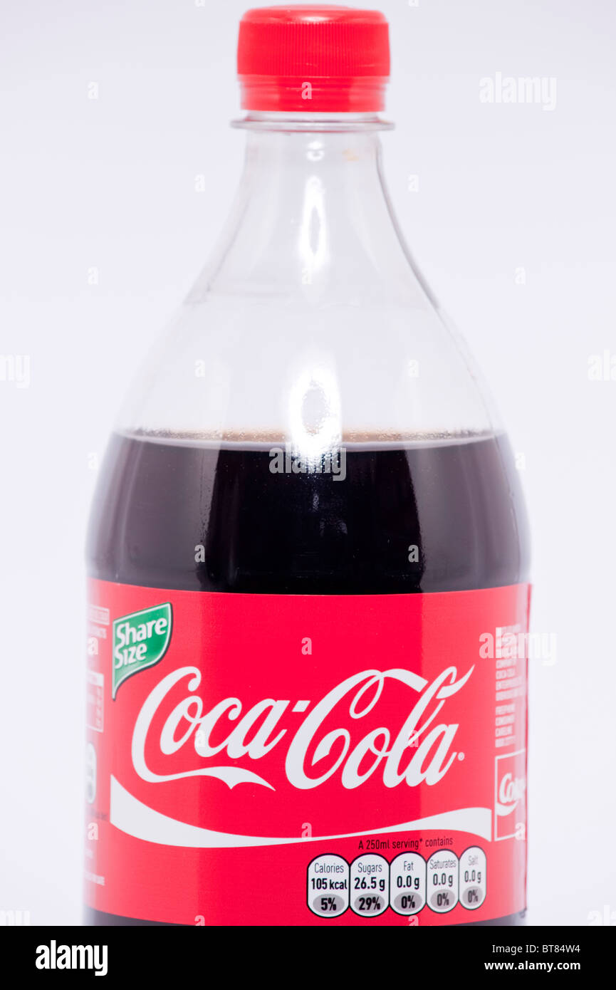 A close up photo of a bottle of Coca Cola coke drink against a white background - Stock Image