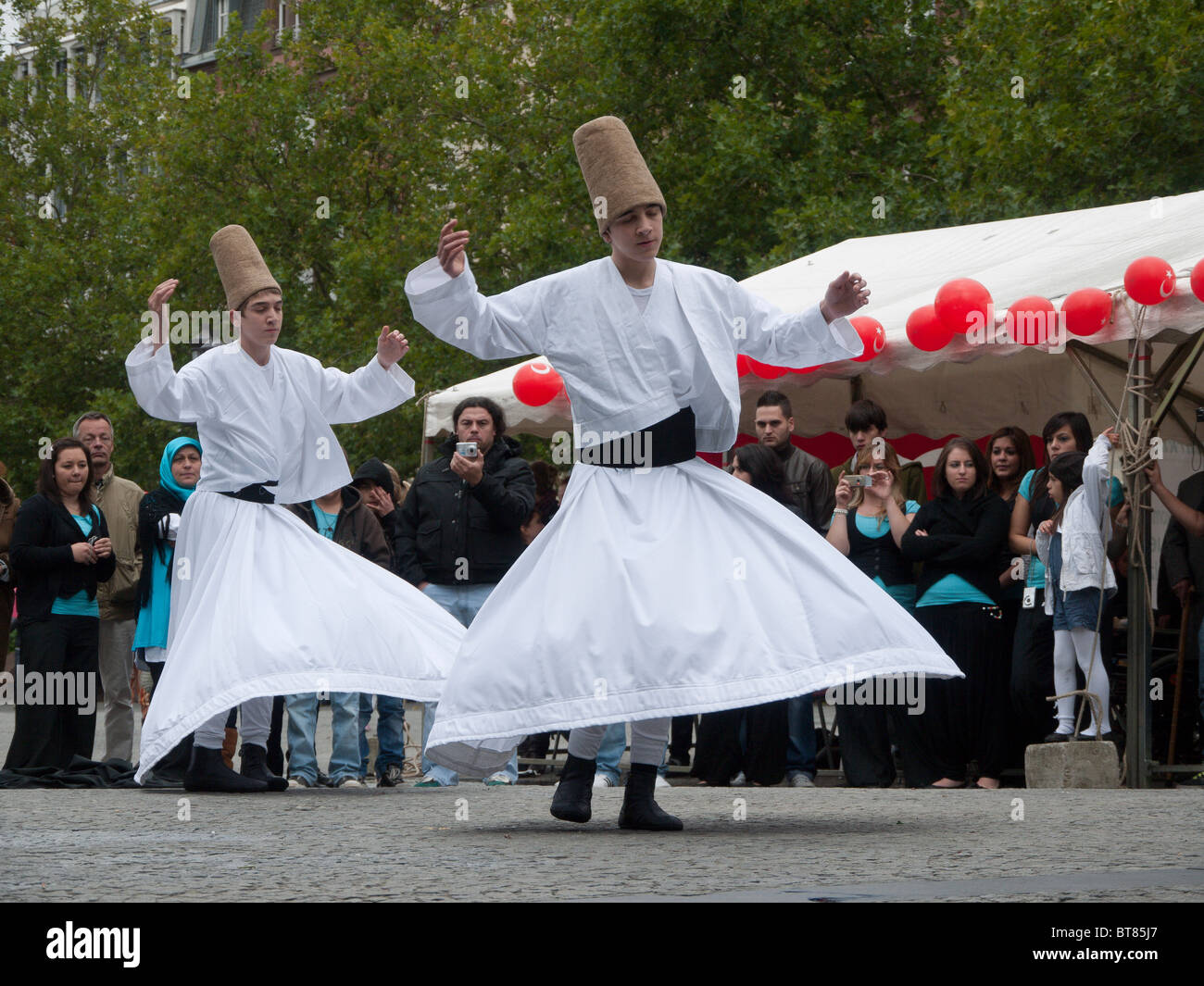 whirling dervishes give a display in Luxembourg City, Luxembourg - Stock Image