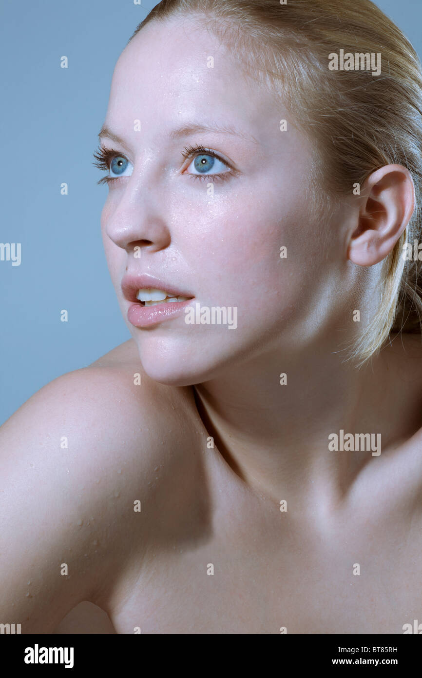 Young woman, waterdrops on her skin - Stock Image