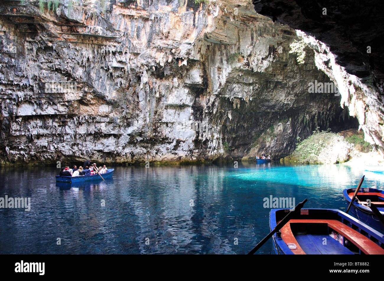 Boating on Melissani Cave Lake, Caves of Sami, near Sami, Kefalonia, Ionian Islands, Greece - Stock Image