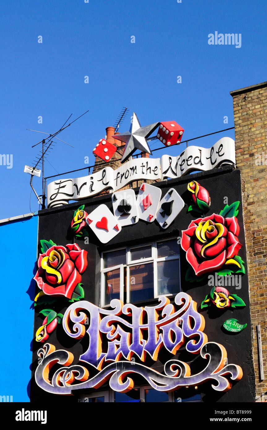 Tattooist's shop sign, Camden High Street, Camden Town, London, England, UK - Stock Image