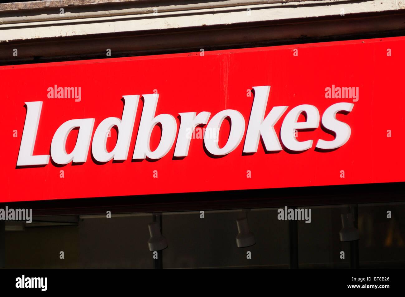 Ladbrokes betting shop sign symbol logo, London, England, UK
