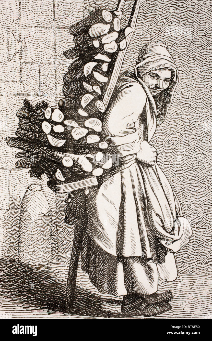 A woman carrying firewood to sell in 18th century Paris. - Stock Image